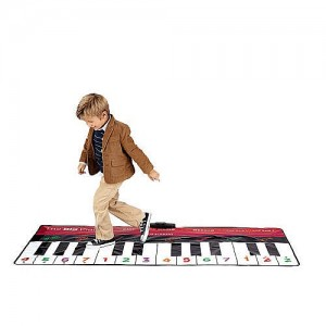 child dances on piano